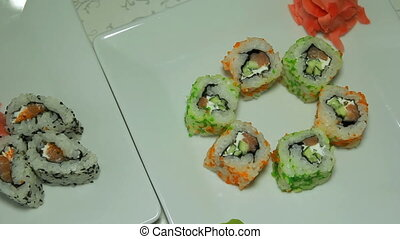 Panoraming of delicious sushi rolls - Panoraming shot of...