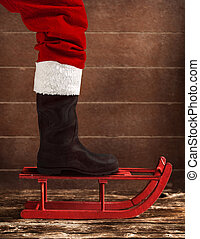 Red sled with the boot of Santa Claus - Wooden red sled with...