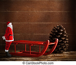 Red sled with pine cone and Santa Claus - Wooden red sled...