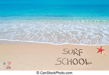 surf school - surf school written on a tropical beach