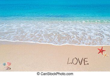 beach love - love written on a tropical beach