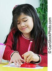 Little girl doing artwork