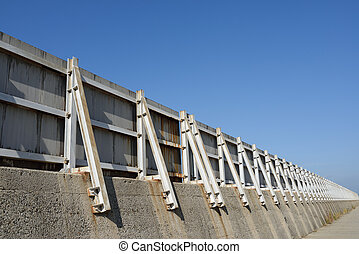breakwater seawall against a blue sky