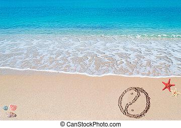"""yin and yang - """"yin and yang"""" symbol drawn on a tropical..."""
