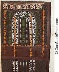 Flower decorated main door of a home during the hindu...