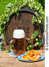 Barrel with hops and a large glass of beer - Beer barrel...