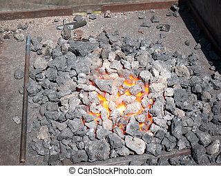 Furnace with hot flaming coal - Red hot coal smouldering in...