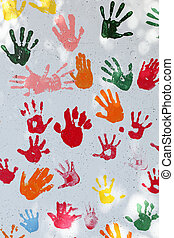 colorful hand prints on white wall background