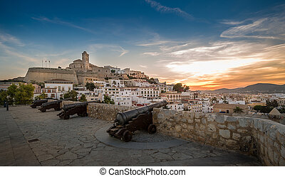 Dalt Vila fortress at sunset - Ibiza fortress and cannon...