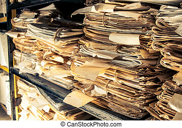 Paper documents in archive - Paper documents stacked in...