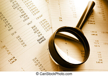 Budget and magnifying glass - Budget papers and magnifying...