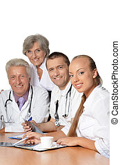 Group of doctors have a discussion at table