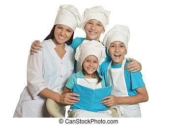 chef with assistants - Happy female chef with assistants...
