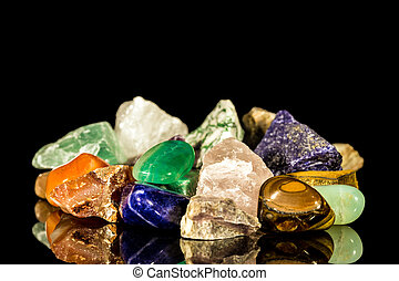 various gemstones, uncut and Tumble finishing