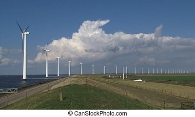 Offshore wind farm and highway along dike + pan Lake...