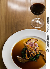 Crispy Duck - Crispy duck on a bed of spinach served with...
