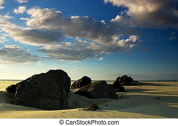 Ninety Mile Beach - A line of rocks in the late afternoon...