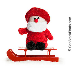 Wooden red sled with Santa Claus plush on white background
