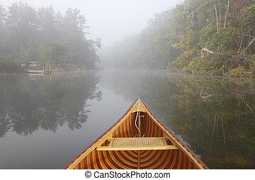 Canoe Bow on a Misty Autumn River