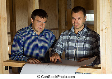 Architect Men with Blueprint Looking at Camera