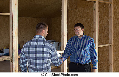 Professional Engineers Showing Handshake at Site - Middle...