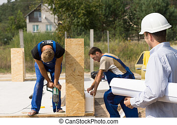 Architect or engineer on a building site