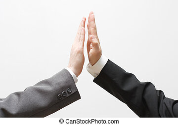 High five - Business men doing a high five