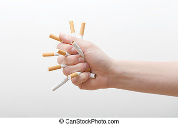Crushing cigarettes - A hand crushing cigarettes