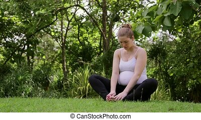 Relaxed pregnant woman doing yoga