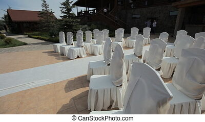 Decorating of wedding ceremony outdoors in the restaurant...