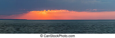 Sunset panorama over ocean - Panoramic sunset with red...