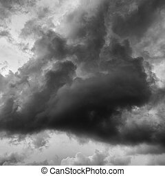 dark storm clouds before rain in black and white