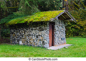 Moss-Covered Stone Well House - A unique old moss-covered...