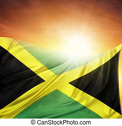 Flag and sky - Jamaican flag in front of bright sky