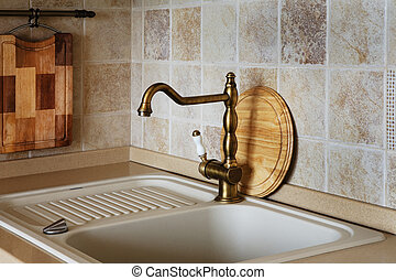 faucet - The beautiful water faucet of bronze color