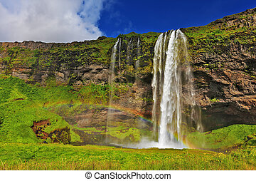 Seljalandsfoss waterfall in Iceland Sunny day in July Large...