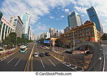 On streets cars and buses go - SHENZHEN - CITY IN SOUTH OF...