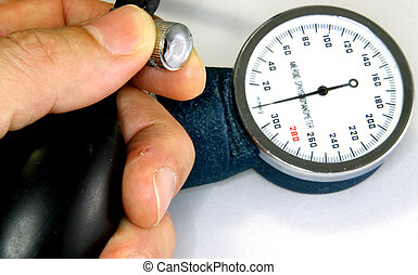 Sphygmomanometer with blood pressure meter and a hand