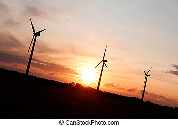 Windmills showing renewable energy in the evening