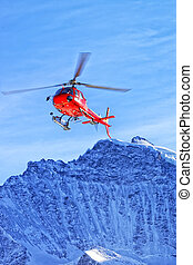 Red helicopte rat swiss alps near Jungfrau mountain - Red...
