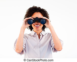 Close-up of smiling businesswoman looking through binoculars