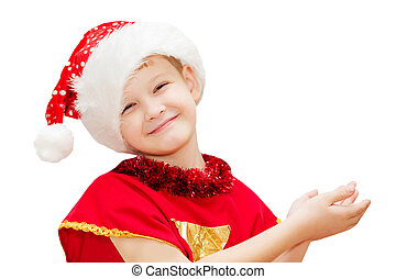 Portrait of a happy christmas child in santa hat isolated in...