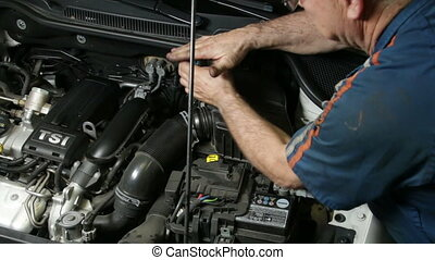 Assembling Automobile Air Filter - A repairman mounting the...