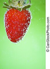 Strawberry with green background - Photo of strawberry in...