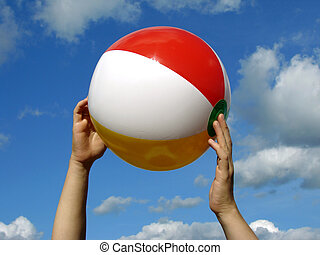 hands with beach ball - child hand with beach ball against...