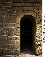 The Emergence - HDR image of old arched stairway in a...