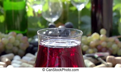 Drops of Red Wine - Glass of red wine close-up on a...
