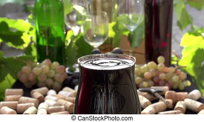 Drop of Wine Create Splashes - Glass of red wine close-up on...