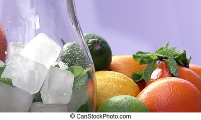 Preparation of Lemonade - In a glass jug with slices of...