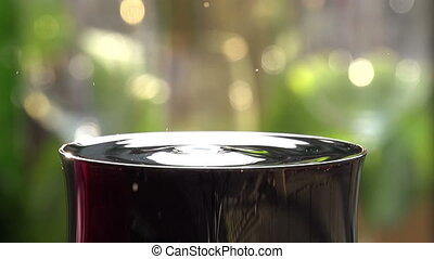 Drop of Wine Close up - Glass of red wine close-up on a...